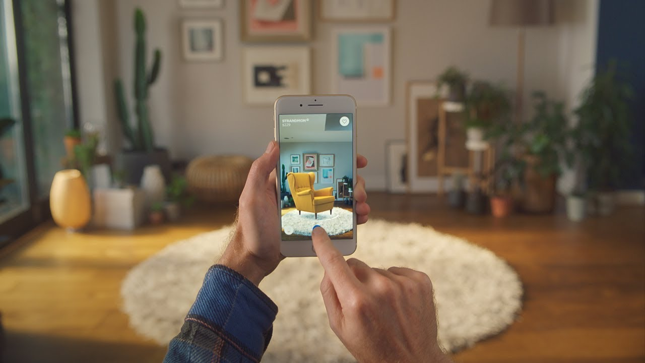 A picture from a person's point of view using a smartphone application that places furniture wherever the user is located. This is called markerless AR.
