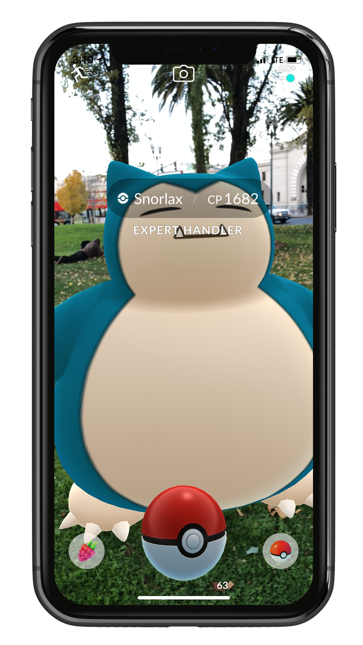 A picture of a smartphone playing PokemonGo which allows users to interact with augmented reality based on their location.