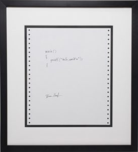 Hello World code written on paper by creator Brian Kernighan.