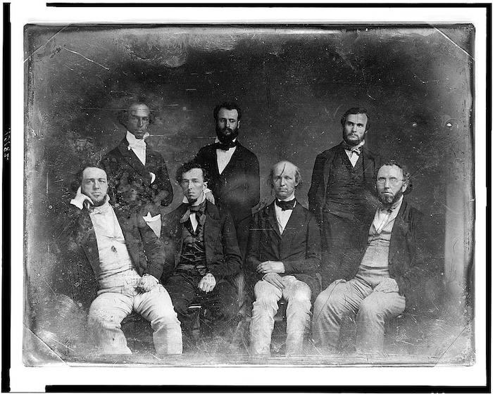 Black and white image of New York Tribune editorial staff.
